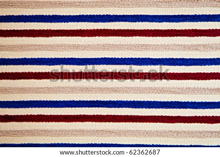 Rough fabric with multi-colored strips - stock photo