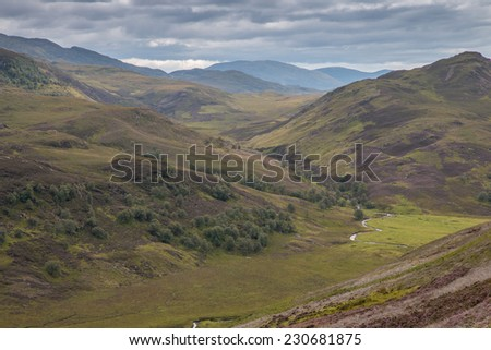 Rough hills and slopes in the Scottish Highlands near Loch Tarff - stock photo