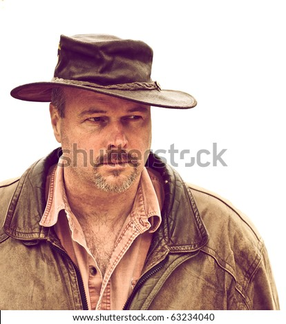Rough looking man looking very suspiciously at something. - stock photo