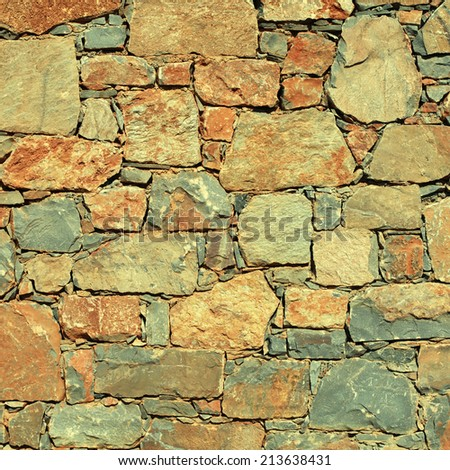 rough mediterranean stone wall as background. instagram effect, square image - stock photo
