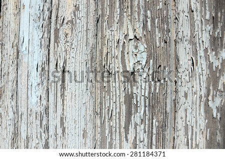 rough old paint peeling off wood surface