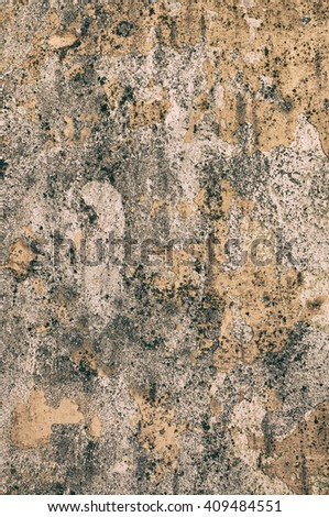 Rough, old wall with peeling paint as background. - stock photo