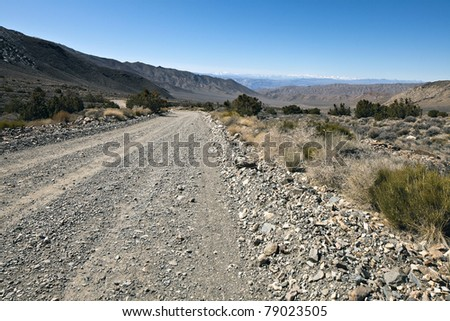Rough road in Death Valley National Park, California. Death Valley is a desert valley located in Eastern California. - stock photo