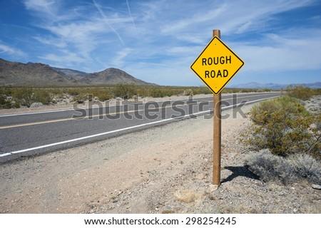 Rough Road Sign Mojave Desert - stock photo