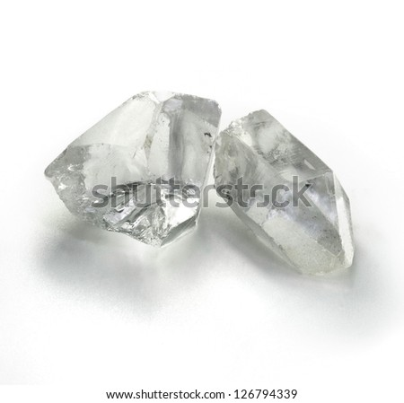 Rough rock crystal gems stones on the simple white background - stock photo