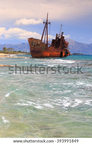 Rough sea and rusty shipwreck near the Selinitsa beach, Gythio, Greece - stock photo