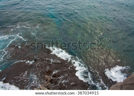 Rough sea view from the top of the cliff - stock photo