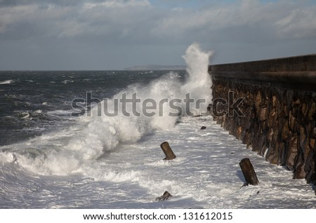 Rough seas and waves breaking over Holyhead Breakwater Isle of Anglesey