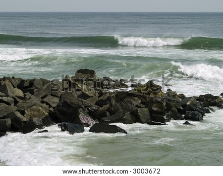 Rough surf on a Spring day along the Jersey Shore. - stock photo