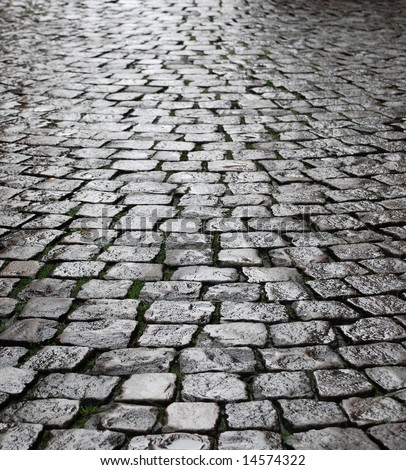 Rough texture of wet block pavement, Saint Malo old side-street - stock photo