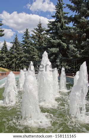 rough water of the fountain as a backdrop - stock photo