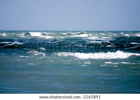 Rough waves of the Atlantic ocean during windstorm - stock photo