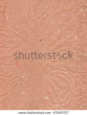 Rough, wrinkled paper in pink tones