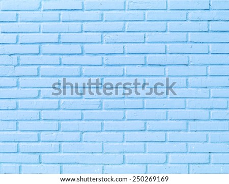 Roughly blue brick wall. Grunge background. - stock photo