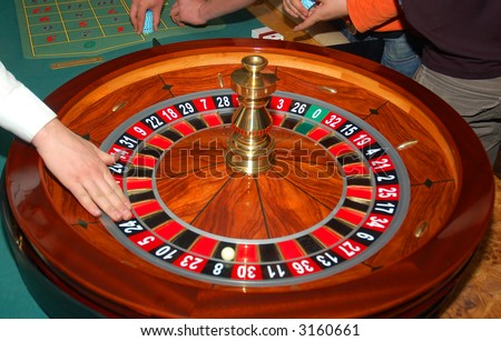 Roulette table and croupier's hand. - stock photo