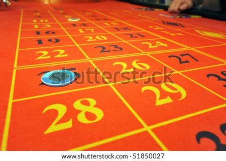 Roulette table with chip on number 25 - stock photo