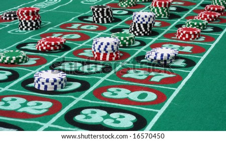 Roulette Table with Chips - stock photo