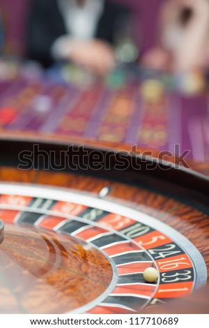 Roulette wheel in motion at casino - stock photo