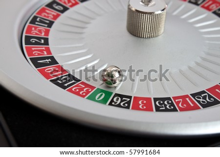 roulette wheel - spinning a winning green zero - stock photo
