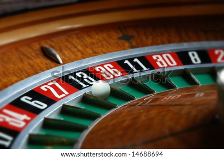 Roulette wheel with ball in thirteen slot - stock photo