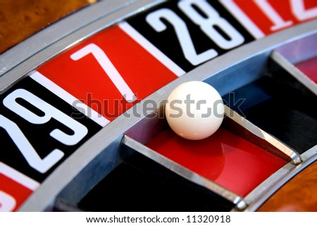 Roulette wheel with ball on 7 - stock photo
