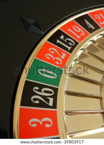 Roulette wheel with focus on zero - stock photo