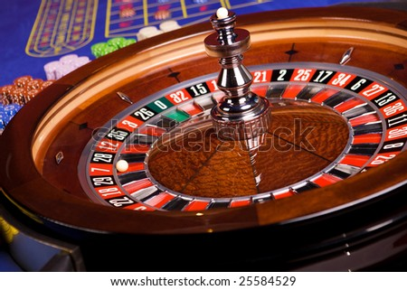 Roulette with roulette table and chips in casino - stock photo