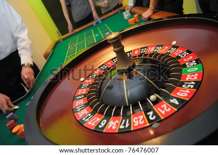 Roulette with the ball on number twenty one - stock photo