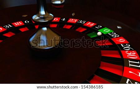 roulette with white ball on zero - stock photo