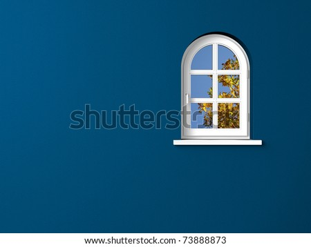 round arch window and blue wall - stock photo