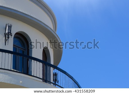 Round balcony under the clear blue sky.