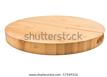 Round Bamboo Chopping Board from low perspective isolated against white background. - stock photo