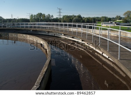 round bassin where the wasted water is being filtered - stock photo