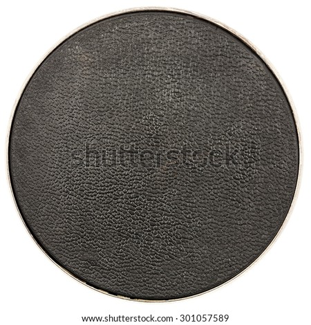 Round black leather table coaster isolated on white - stock photo