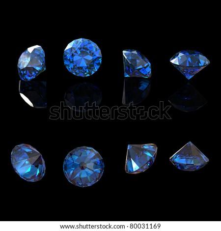 Round blue sapphire isolated on black background. Gemstone - stock photo