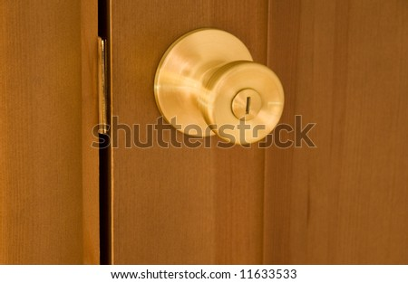 round brass handle of room door - stock photo