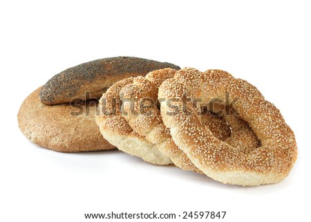Round bread and gold bagels with sesame