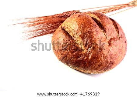 Round bread from a flour of a rough grinding and ears on a white background. - stock photo