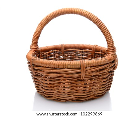 Round brown wicker basket with handle isolated on a white background with slight reflection. - stock photo