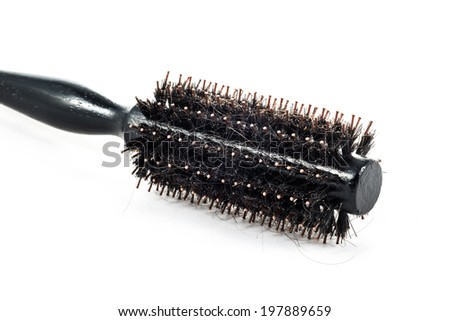 Round brush with hair fall in white background - stock photo