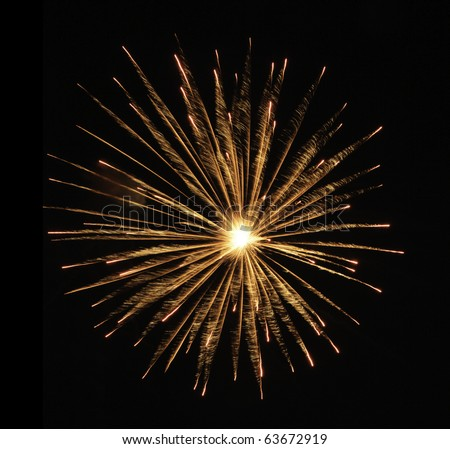 Round burst of orange fireworks with feathery motion blur and white-hot core of explosion - stock photo