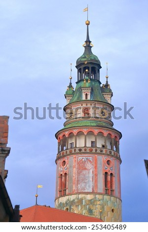 Round castle tower above the streets of the historical town of Cesky Krumlov, Czech Republic - stock photo