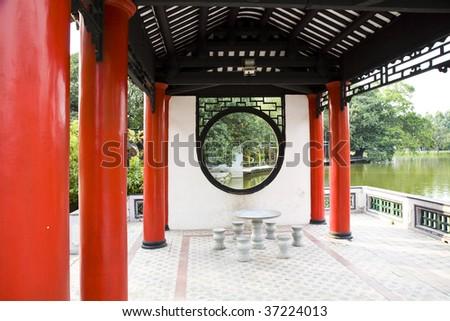 Round Chinese window  in garden - stock photo