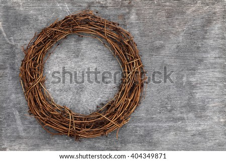 round christmas tree wreath on grunge wood background