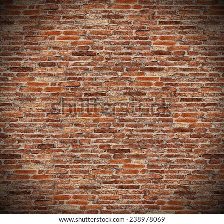 round circle spotlight on red brick wall, radial gradient shadow on old dark brown, orange brick fences or grungy rusty blocks of stone work for texture and background - stock photo