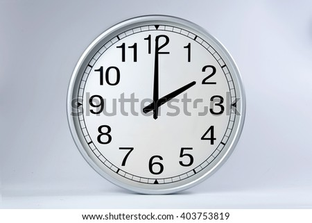 Round clock shows shows at 2 o'clock,  - stock photo