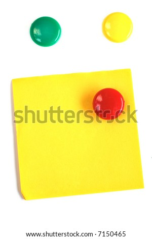 Round colored magnets with blank yellow post-it isolated on white - stock photo