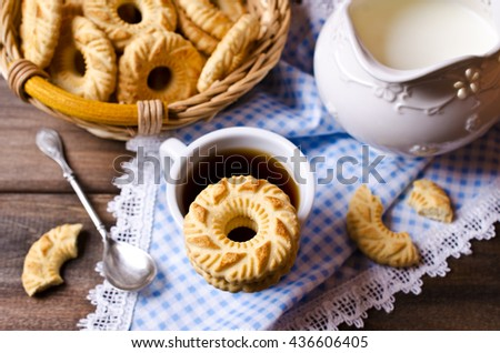 Round cookies with an ornament on a dark wooden background. Selective focus. - stock photo
