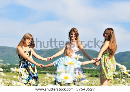 round dance in the summer daisy field - stock photo