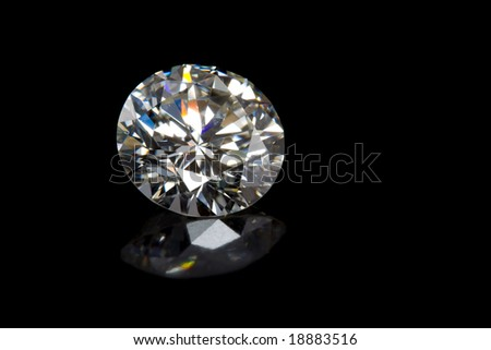 Round Diamond on Black Background with Reflection - stock photo